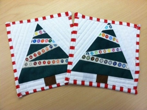http://www.quiltingboard.com/pictures-f5/selvage-christmas-tree-mug-rugs-t168478.html